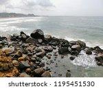 sea water crashing with rocks | Shutterstock . vector #1195451530