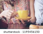 woman hands holding cup of... | Shutterstock . vector #1195456150