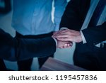 two businessman shaking hands... | Shutterstock . vector #1195457836