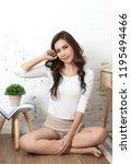 young beautiful asian woman sit ... | Shutterstock . vector #1195494466