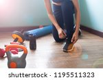 woman tying shoes for exercise  ... | Shutterstock . vector #1195511323