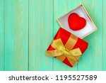 red heart in gift box on wooden ... | Shutterstock . vector #1195527589