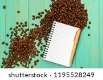 scattered coffee beans with... | Shutterstock . vector #1195528249
