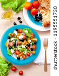 greek salad in a turquoise... | Shutterstock . vector #1195551730