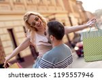 happy couple with shopping bags ... | Shutterstock . vector #1195557946