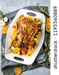 christmas roast duck served on...   Shutterstock . vector #1195560889