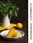 plate with ripe corn cobs on... | Shutterstock . vector #1195568173