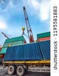 container unit being lifting... | Shutterstock . vector #1195581883