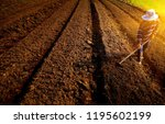 Agricultural worker with hoe.Handmade plowing farmer.Traditional agriculture. soft ligth in morning.