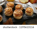 wooden board with apple roses... | Shutterstock . vector #1195613116