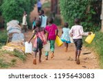 Children Carrying Water Cans I...