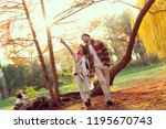 young couple in love holding... | Shutterstock . vector #1195670743