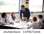 male high school tutor standing ... | Shutterstock . vector #1195671646