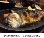 grilled saba soy sauce on a hot ... | Shutterstock . vector #1195678459