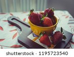 strawberries on a vintage... | Shutterstock . vector #1195723540