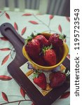 strawberries on a vintage... | Shutterstock . vector #1195723543