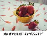 strawberries on a vintage... | Shutterstock . vector #1195723549