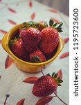 strawberries on a vintage... | Shutterstock . vector #1195723600