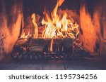 logs burning in a fireplace... | Shutterstock . vector #1195734256