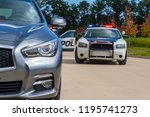 Two Police Vehicles Stop A...