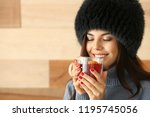 woman with glass cup of... | Shutterstock . vector #1195745056