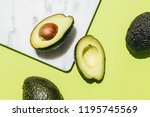 fresh organic hass avocados on... | Shutterstock . vector #1195745569