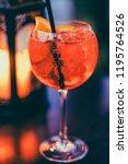 cocktail glass on outdoor bar... | Shutterstock . vector #1195764526