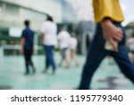 blurry people walking with... | Shutterstock . vector #1195779340