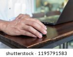 asian tan skin holding wireless ...   Shutterstock . vector #1195791583