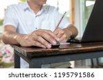 asian tan skin holding wireless ...   Shutterstock . vector #1195791586
