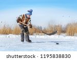 young hockey boy trains alone... | Shutterstock . vector #1195838830