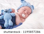 sleeping baby with pacifier | Shutterstock . vector #1195857286