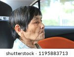 asian old woman sitting on car... | Shutterstock . vector #1195883713