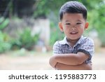 asian boy smiling happily and... | Shutterstock . vector #1195883773