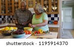 retired black couple cooking in ... | Shutterstock . vector #1195914370