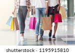 three consumers with paperbags... | Shutterstock . vector #1195915810