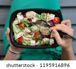 food delivery service. woman... | Shutterstock . vector #1195916896