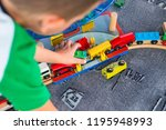 little child playing with... | Shutterstock . vector #1195948993