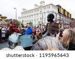 giant little boy rides through...   Shutterstock . vector #1195965643