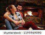 happy hugging couple enjoying... | Shutterstock . vector #1195969090