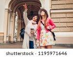 two women tourists talking...   Shutterstock . vector #1195971646