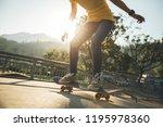 skateboarder skateboarding at... | Shutterstock . vector #1195978360