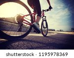 woman cyclist legs riding... | Shutterstock . vector #1195978369