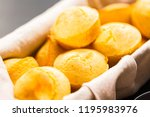 Stock photo freshly baked cornbread muffins in basket 1195983976
