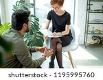 female psychologist consulting... | Shutterstock . vector #1195995760
