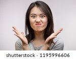 annoyed frowning asian woman... | Shutterstock . vector #1195996606