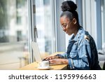 side view of african woman in... | Shutterstock . vector #1195996663