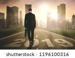 rear view of male entrepreneur... | Shutterstock . vector #1196100316