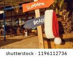 santa claus hat on the beach on ... | Shutterstock . vector #1196112736