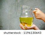 hands holding a jar of rice... | Shutterstock . vector #1196130643
